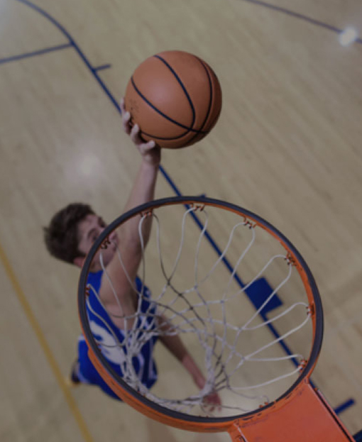 A student practicing at a basketball training session
