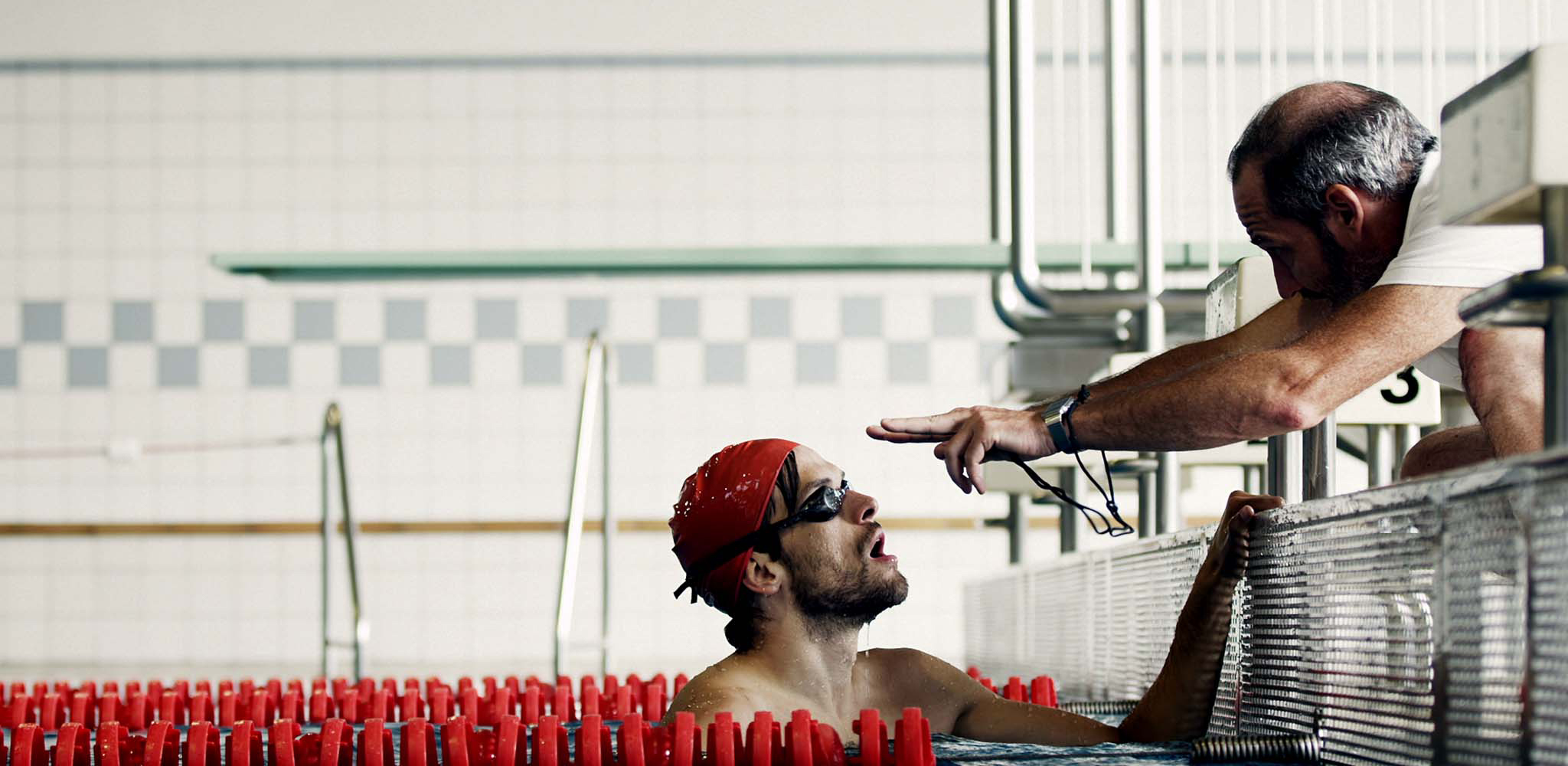 A swimmer getting instructions from a coach